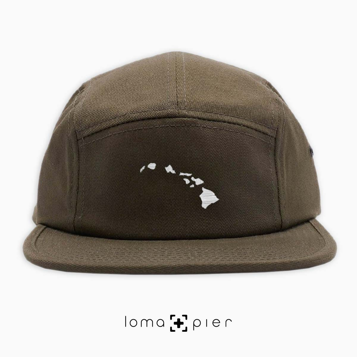 HAWAIIAN ISLANDS icon embroidered on an olive green cotton 5-panel hat by loma+pier hat store
