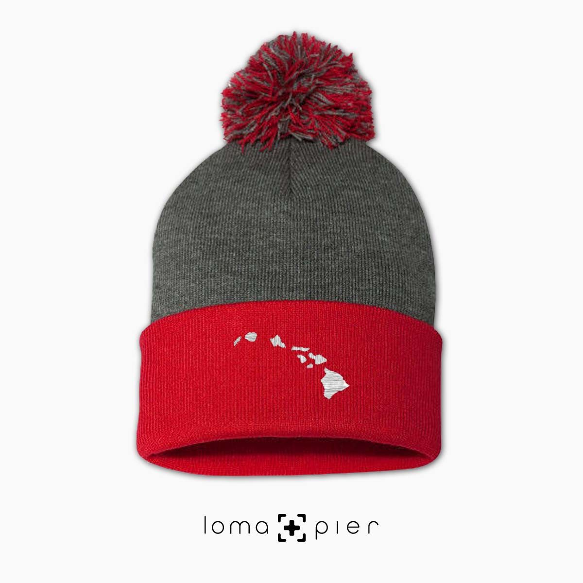 HAWAIIAN ISLANDS icon embroidered on a grey red pom pom hawaii beanie by loma+pier hat store