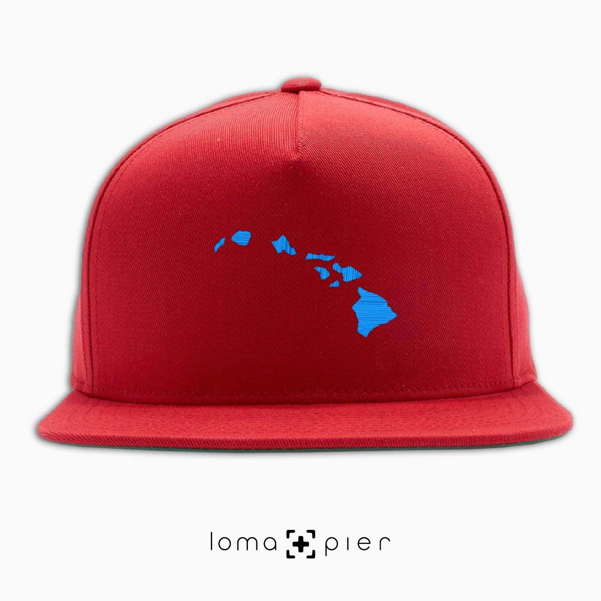 HAWAIIAN ISLANDS icon embroidered on a red classic snapback hat by loma+pier hat store