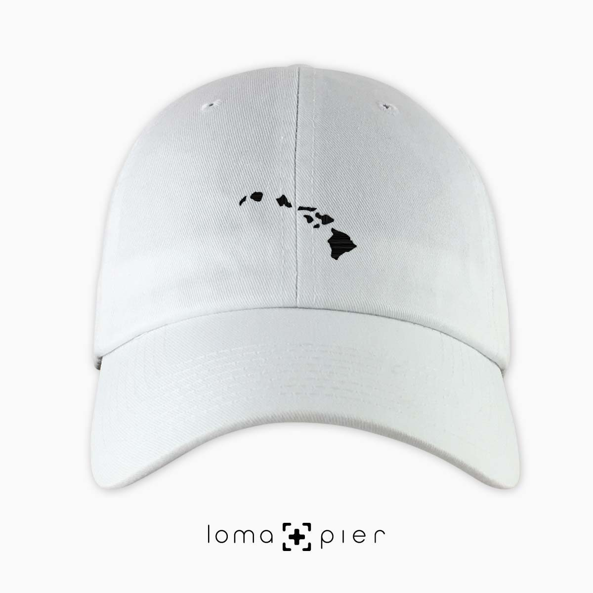 HAWAIIAN ISLANDS icon embroidered on a white hawaii dad hat by loma+pier hat store made in the USA