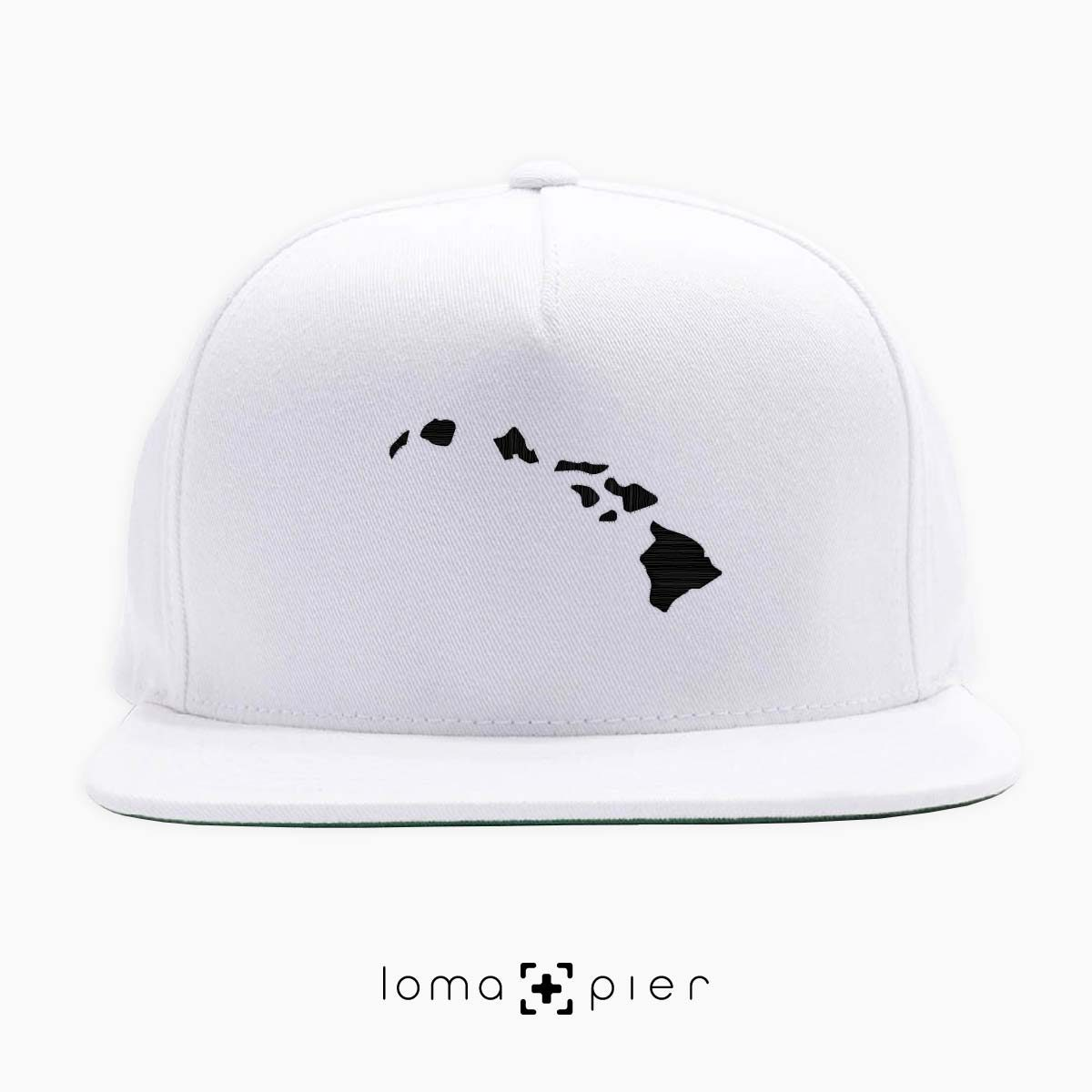 HAWAIIAN ISLANDS icon embroidered on a white classic snapback hat by loma+pier hat store