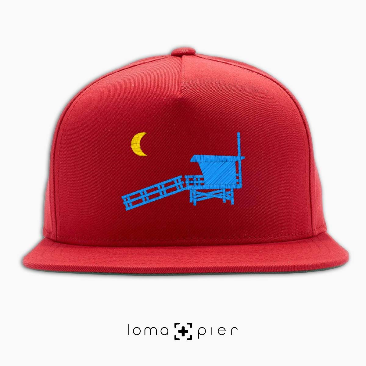 hermosa beach LIFEGUARD TOWER icon embroidered on a red classic snapback hat by loma+pier hat store
