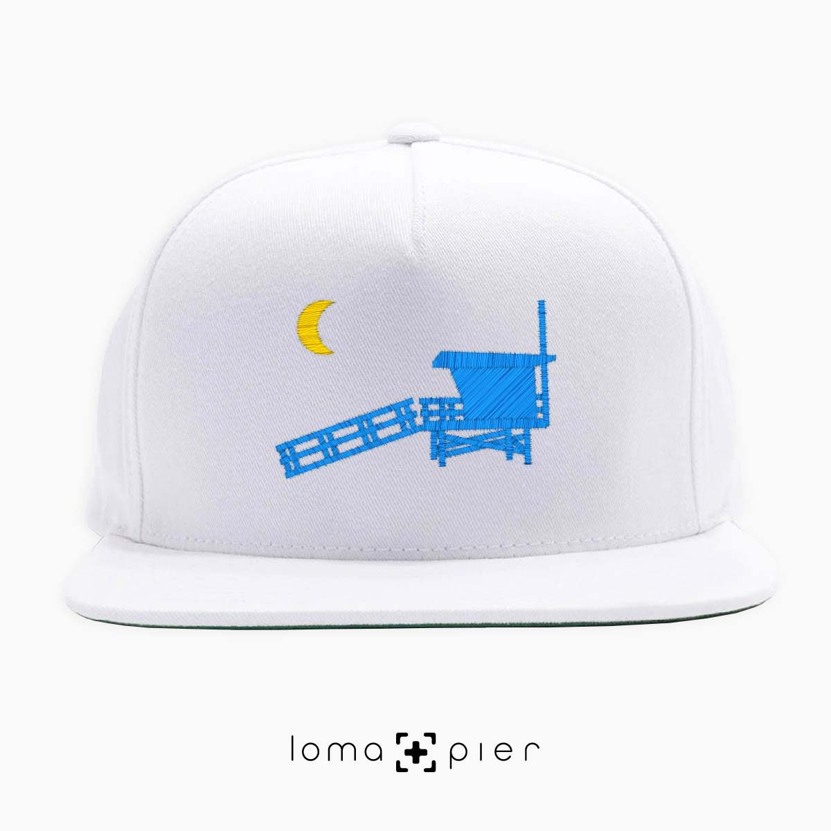 hermosa beach LIFEGUARD TOWER icon embroidered on a white classic snapback hat by loma+pier hat store