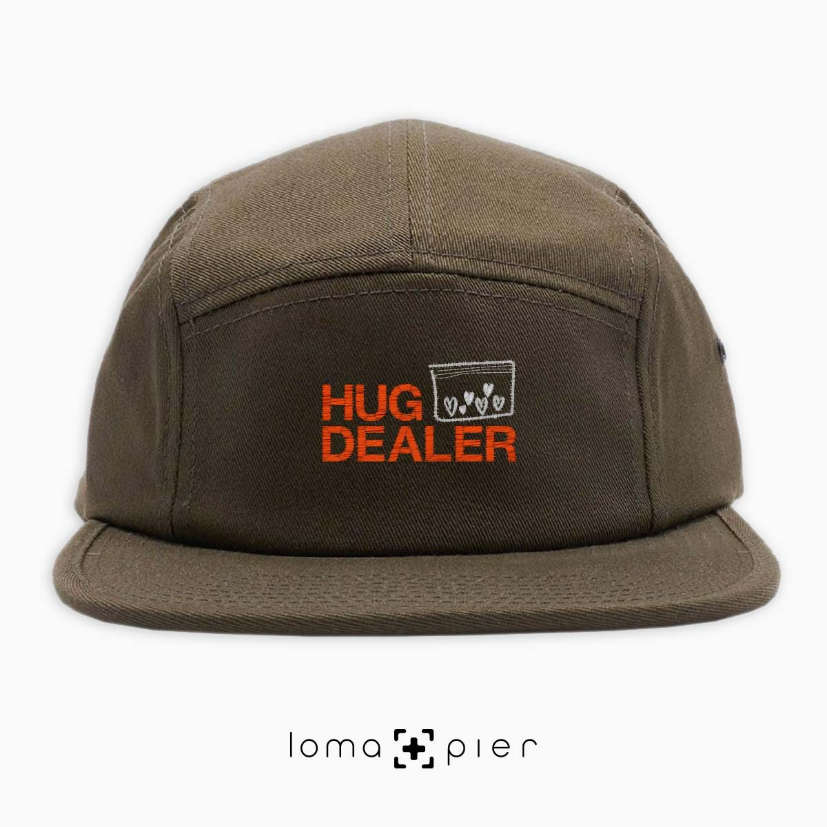 HUG DEALER icon embroidered on an olive green cotton 5-panel hat with multicolor thread by loma+pier hat store