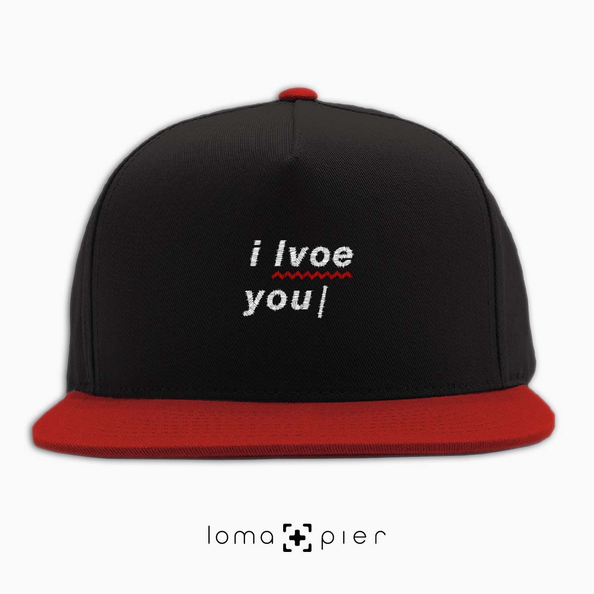 I LVOE YOU typography embroidered on a black and red classic snapback hat with white thread by loma+pier hat store