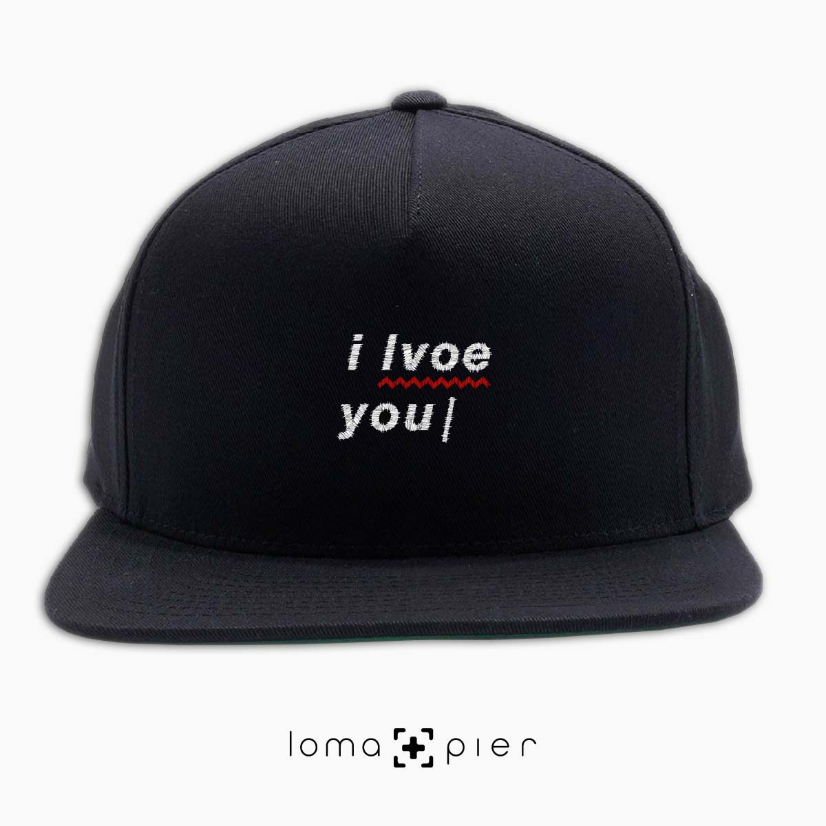 I LVOE YOU typography embroidered on a black classic snapback hat with white thread by loma+pier hat store