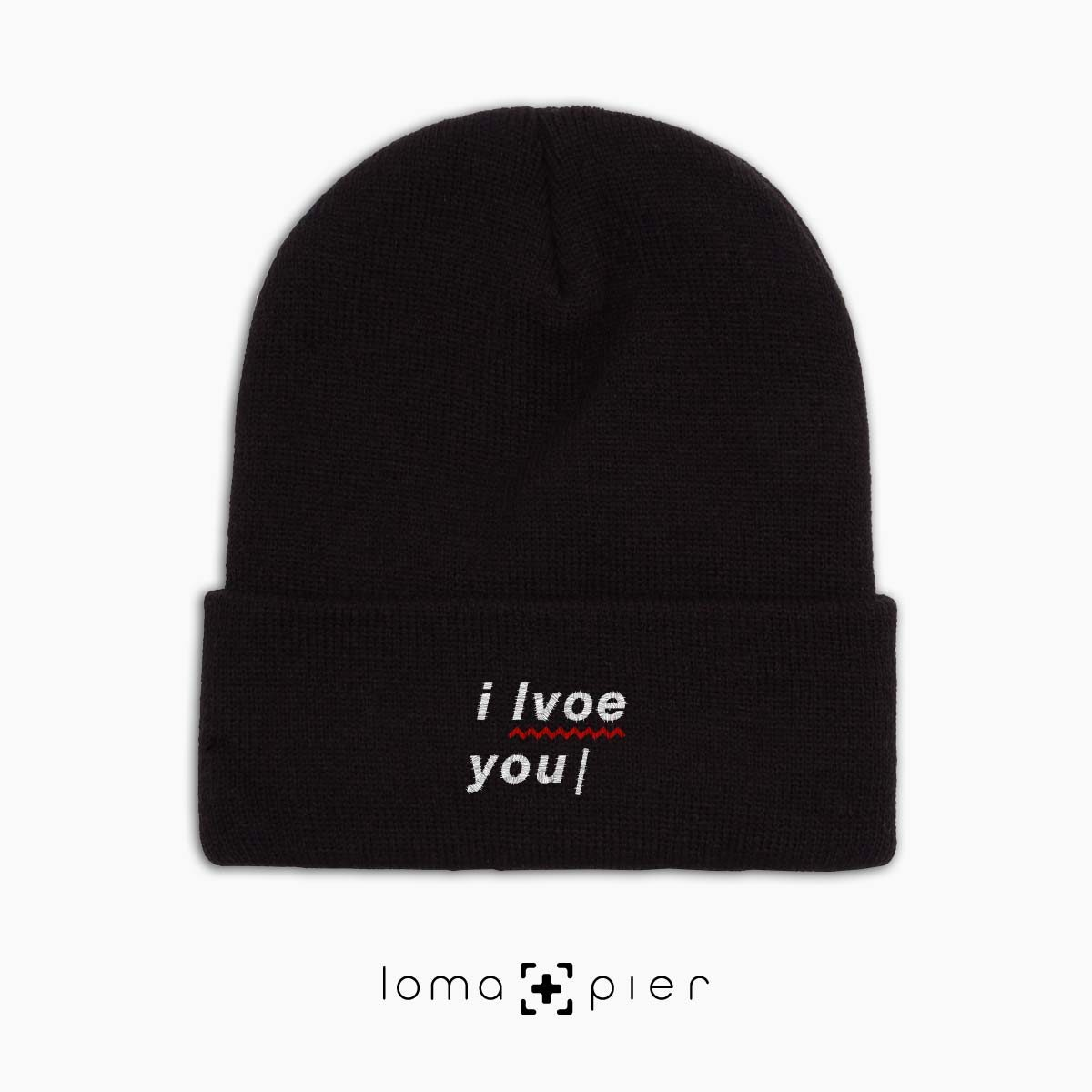 I LVOE YOU typography embroidered on a black cuffed beanie with white thread by loma+pier hat store made in the USA