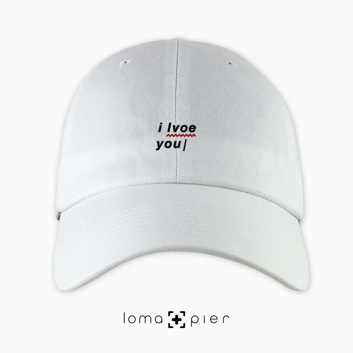 I LVOE YOU typography embroidered on a white unstructured dad hat with black thread by loma+pier hat store made in the USA