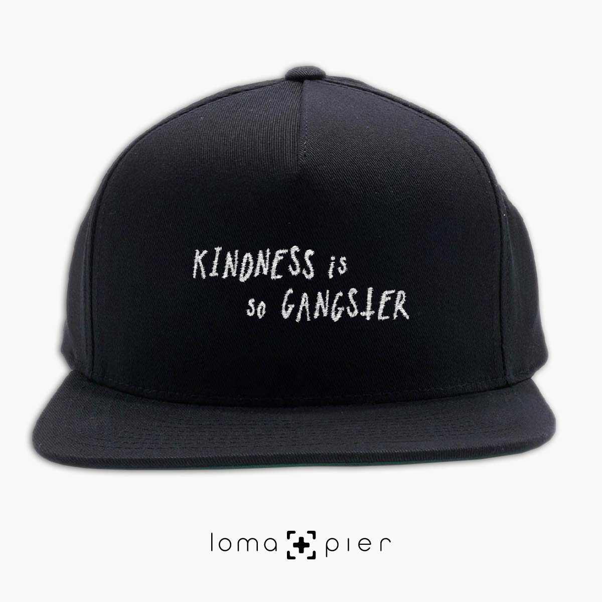 KINDNESS IS SO GANGSTER typography embroidered on a black classic snapback hat with white thread by loma+pier hat store