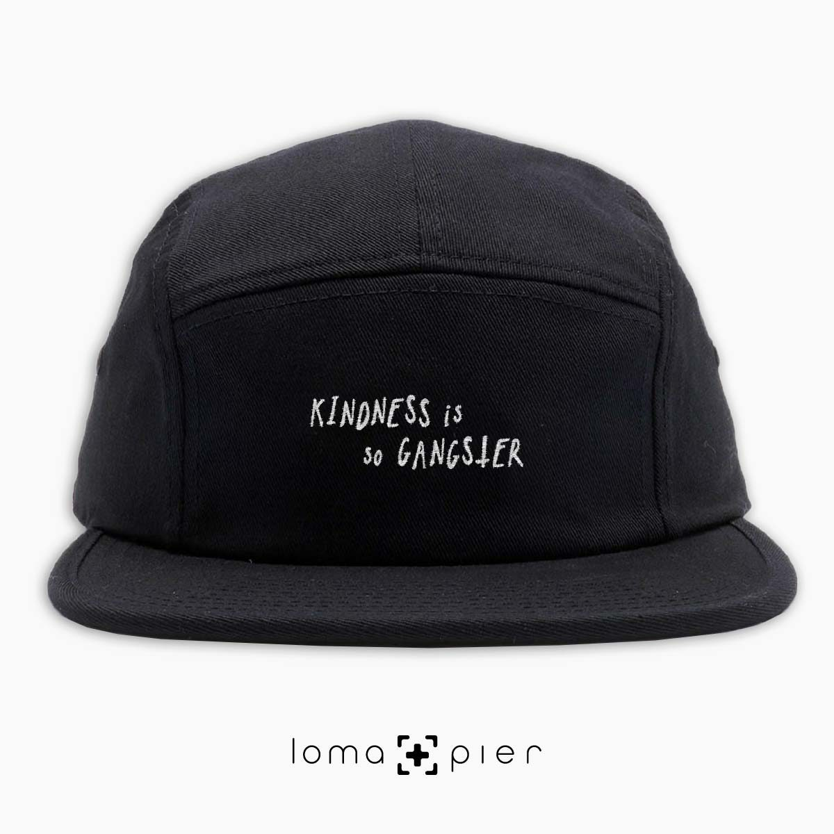 KINDNESS IS SO GANGSTER typography embroidered on a black cotton 5-panel hat with white thread by loma+pier hat store