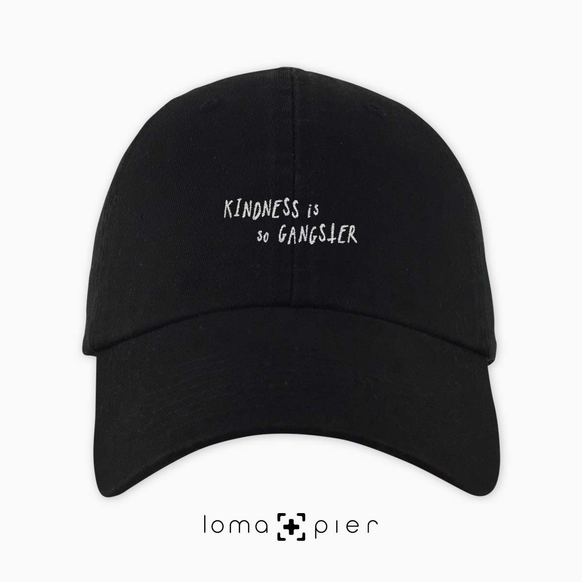 KINDNESS IS SO GANGSTER typography embroidered on a black unstructured dad hat with white thread by loma+pier hat store made in the USA
