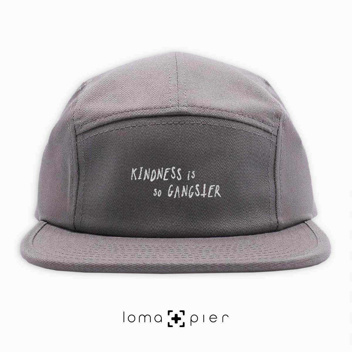 KINDNESS IS SO GANGSTER typography embroidered on a grey cotton 5-panel hat with white thread by loma+pier hat store