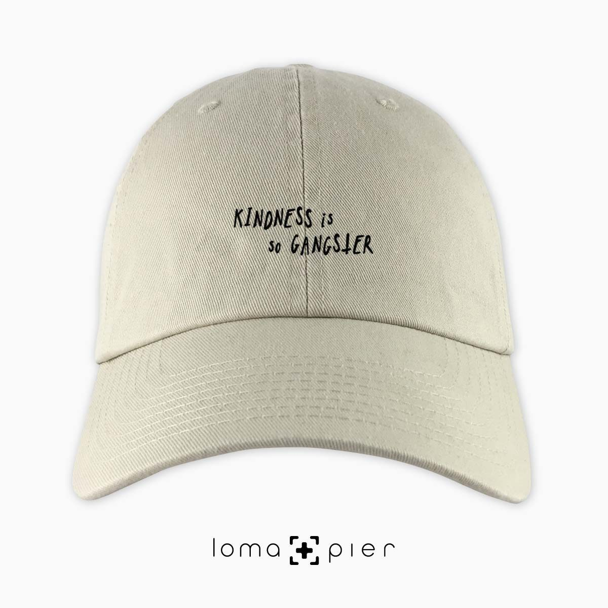 KINDNESS IS SO GANGSTER typography embroidered on a khaki unstructured dad hat with black thread by loma+pier hat store made in the USA