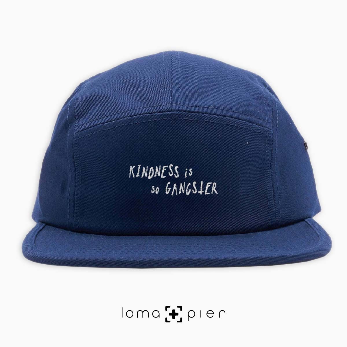 KINDNESS IS SO GANGSTER typography embroidered on a navy blue cotton 5-panel hat with white thread by loma+pier hat store