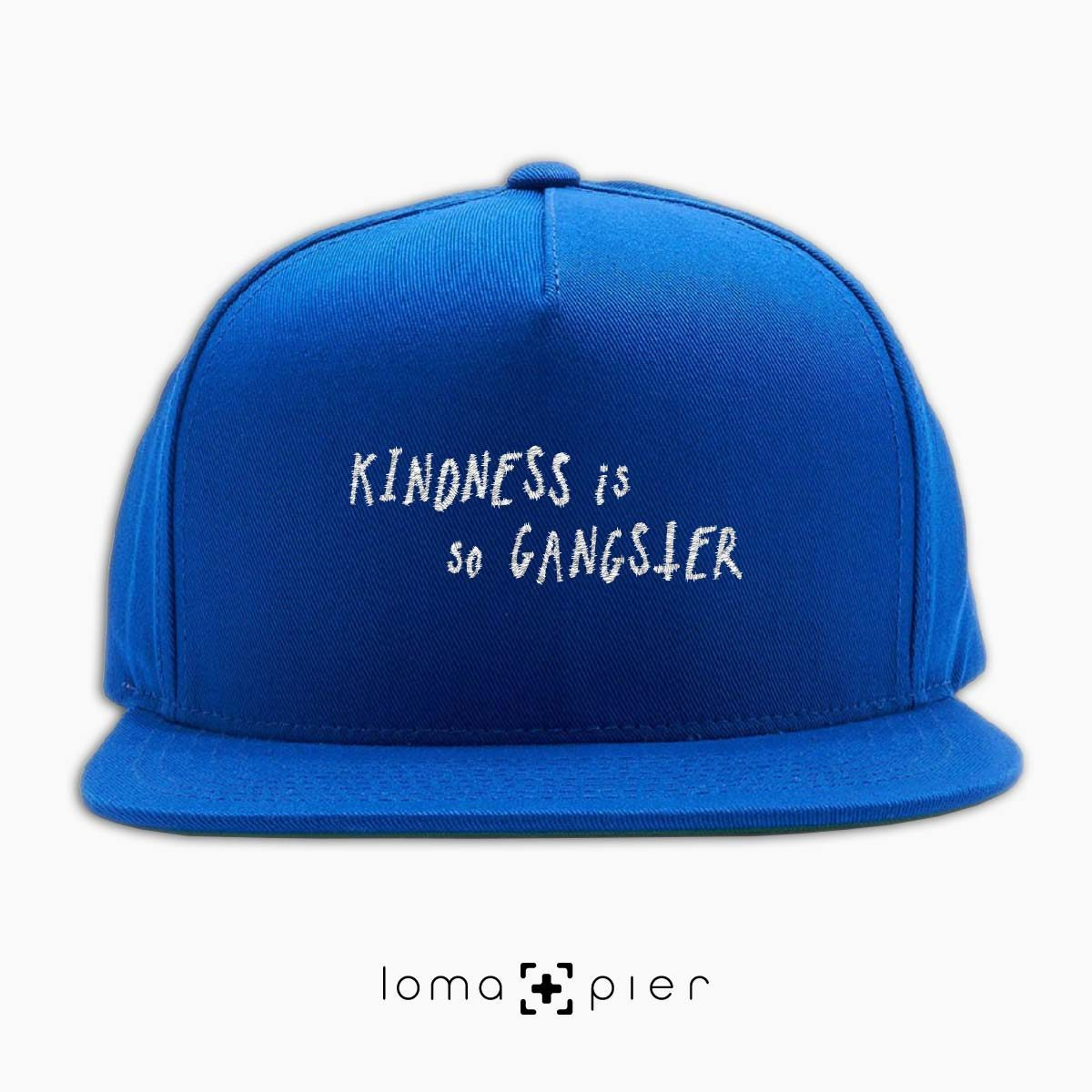 KINDNESS IS SO GANGSTER typography embroidered on a royal blue classic snapback hat with white thread by loma+pier hat store