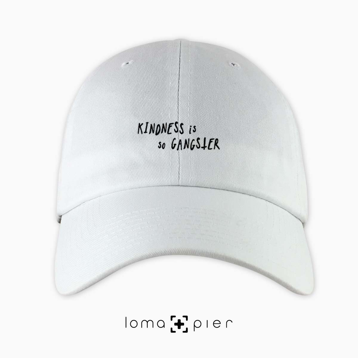 KINDNESS IS SO GANGSTER typography embroidered on a white unstructured dad hat with black thread by loma+pier hat store made in the USA