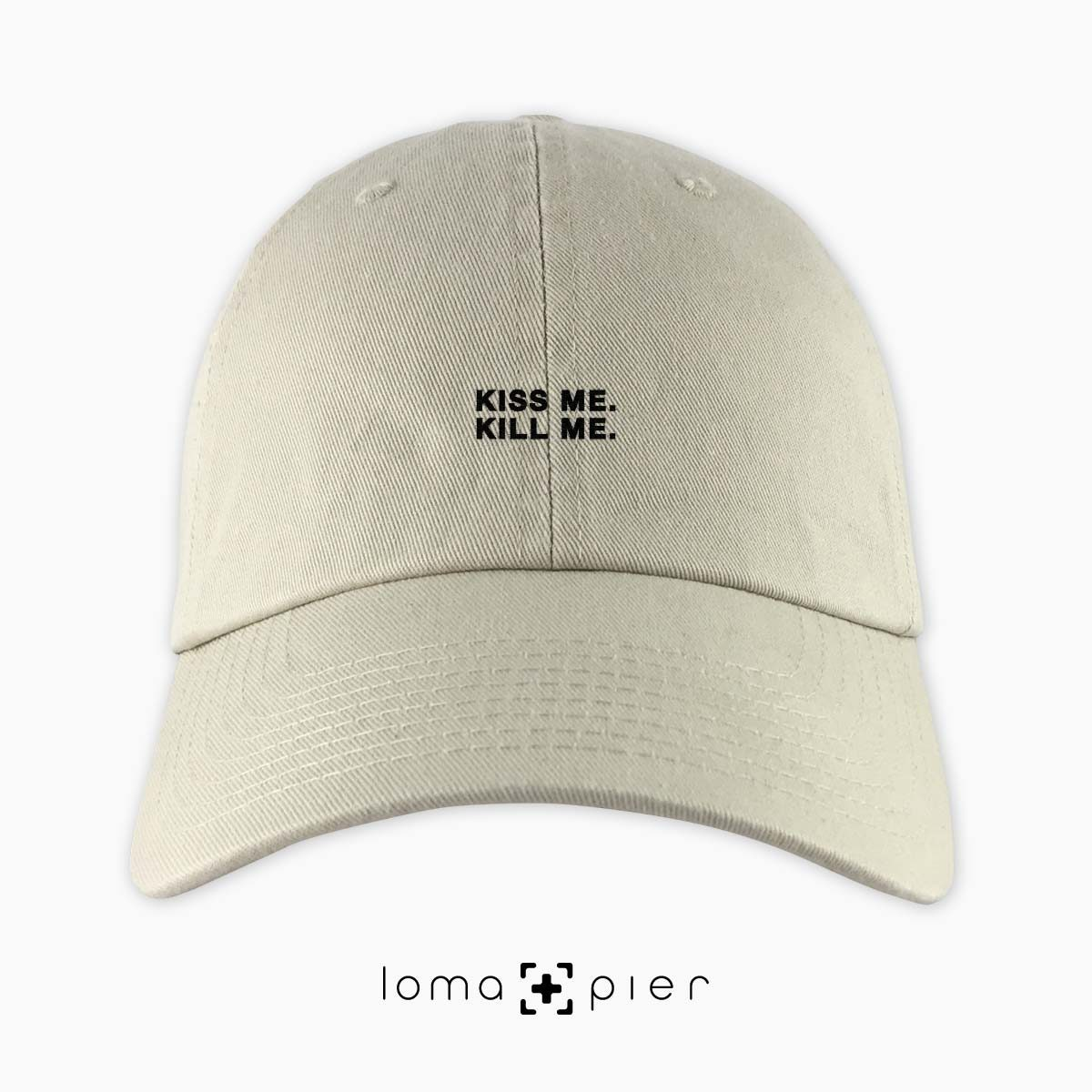 KISS ME. KILL ME. typography embroidered on a khaki unstructured dad hat with black thread by loma+pier hat store made in the USA