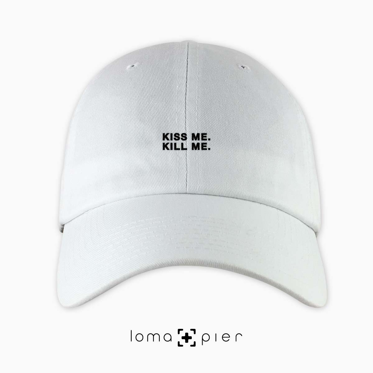 KISS ME. KILL ME. typography embroidered on a white unstructured dad hat with black thread by loma+pier hat store made in the USA