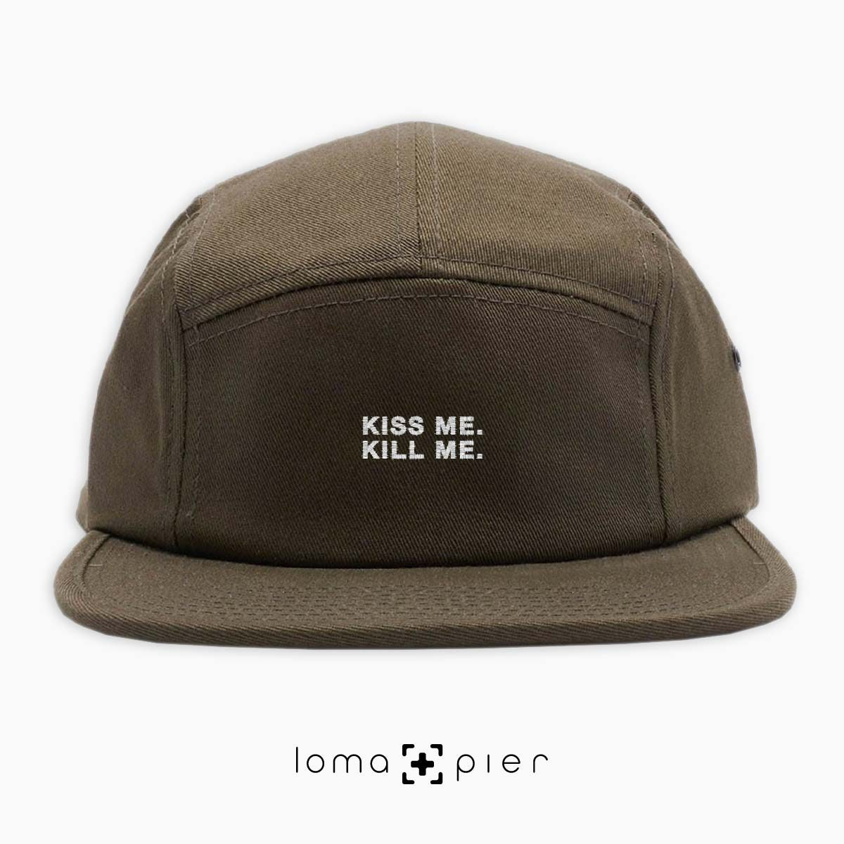 KISS ME. KILL ME. typography embroidered on an olive green cotton 5-panel hat with white thread by loma+pier hat store