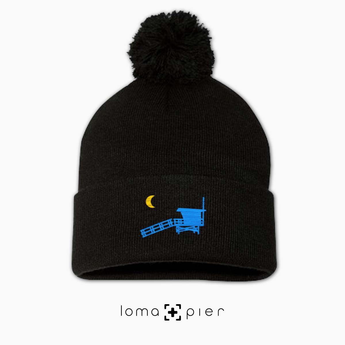 LIFEGUARD TOWER icon embroidered on a black pom pom beanie by loma+pier hat store