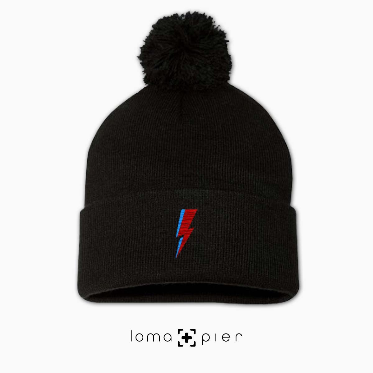LIGHTNING BOLT icon embroidered on a black pom pom beanie with multicolor thread by loma+pier hat store