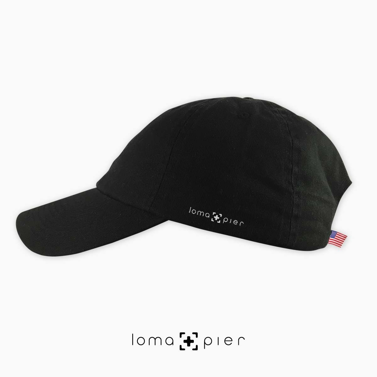 black unstructured dad hat with loma+pier logo on left side by loma+pier hat store made in the USA