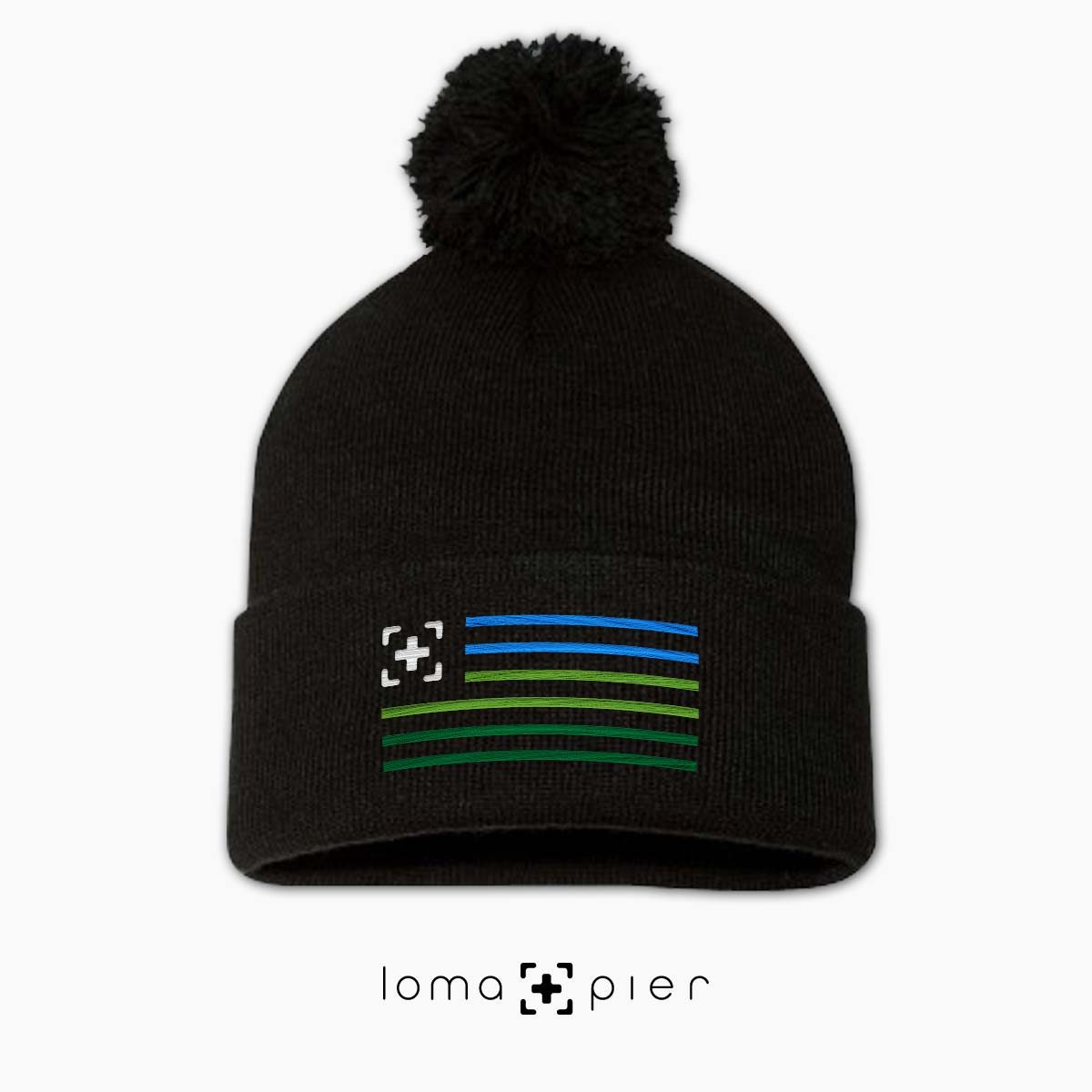loma+stripes icon embroidered on a black pom pom beanie by loma+pier beanie store