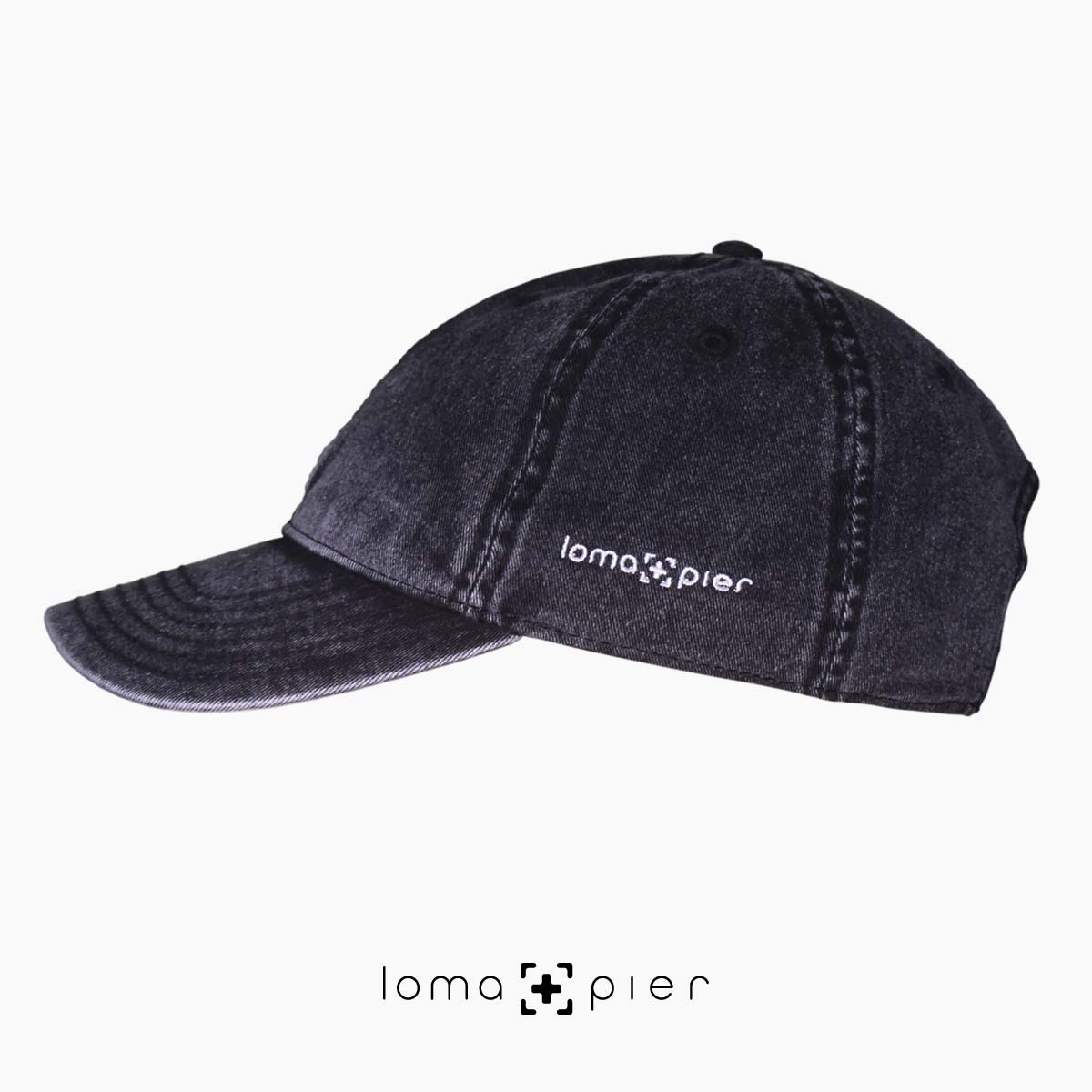 black washed out vintage dad hats with loma and pier logo
