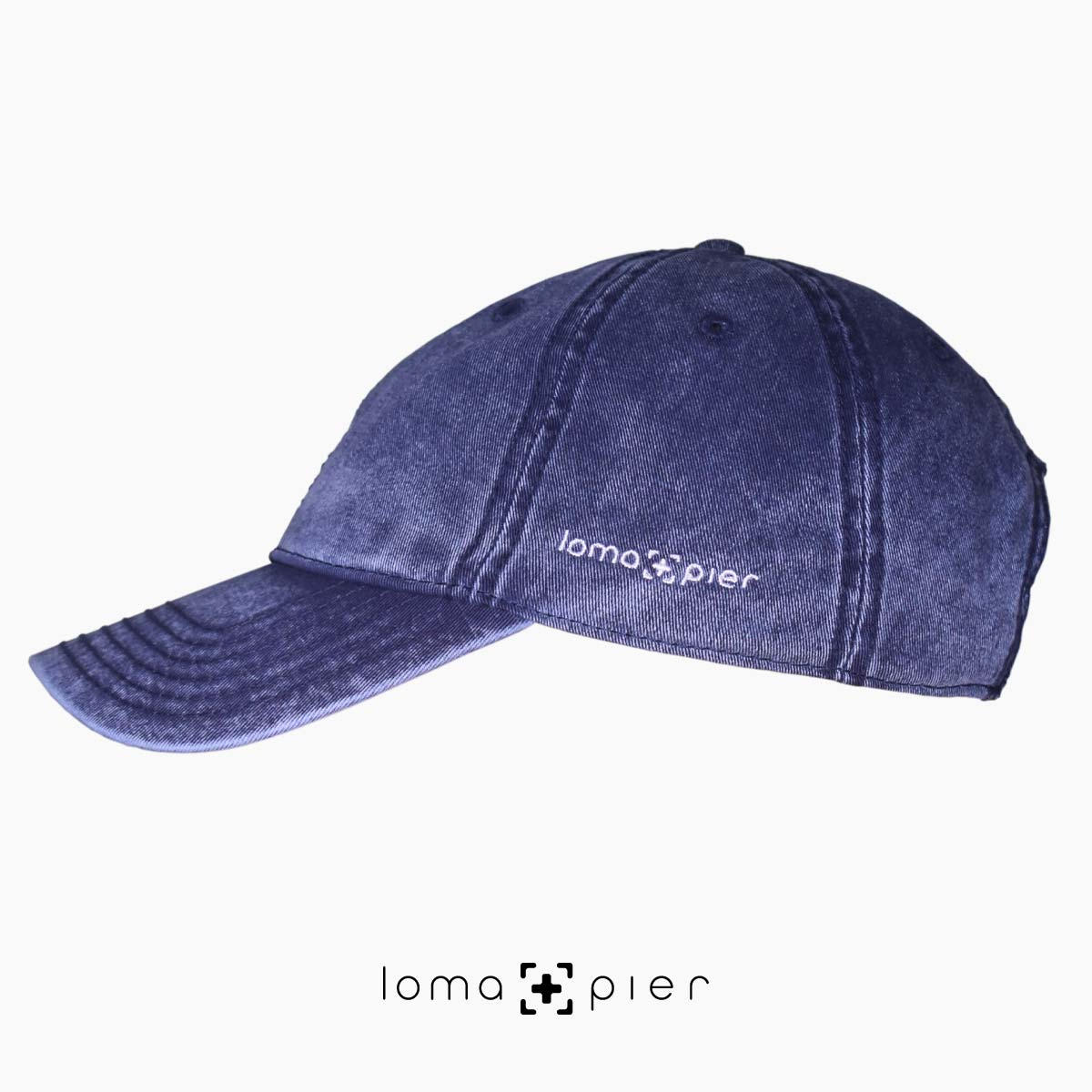 navy washed out vintage dad hats with loma and pier logo