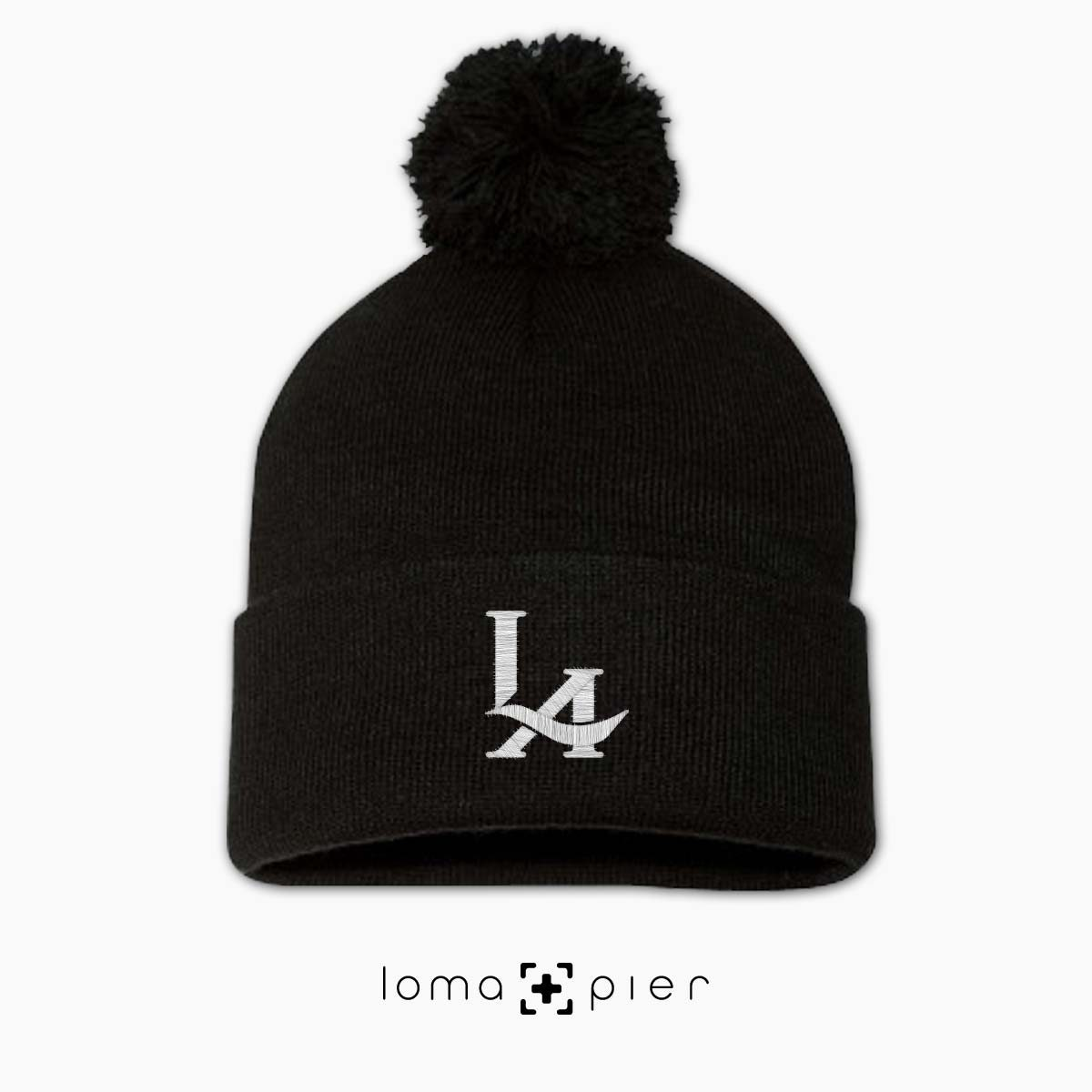 los angeles LA LOGO icon embroidered on a black pom pom beanie by loma+pier hat store