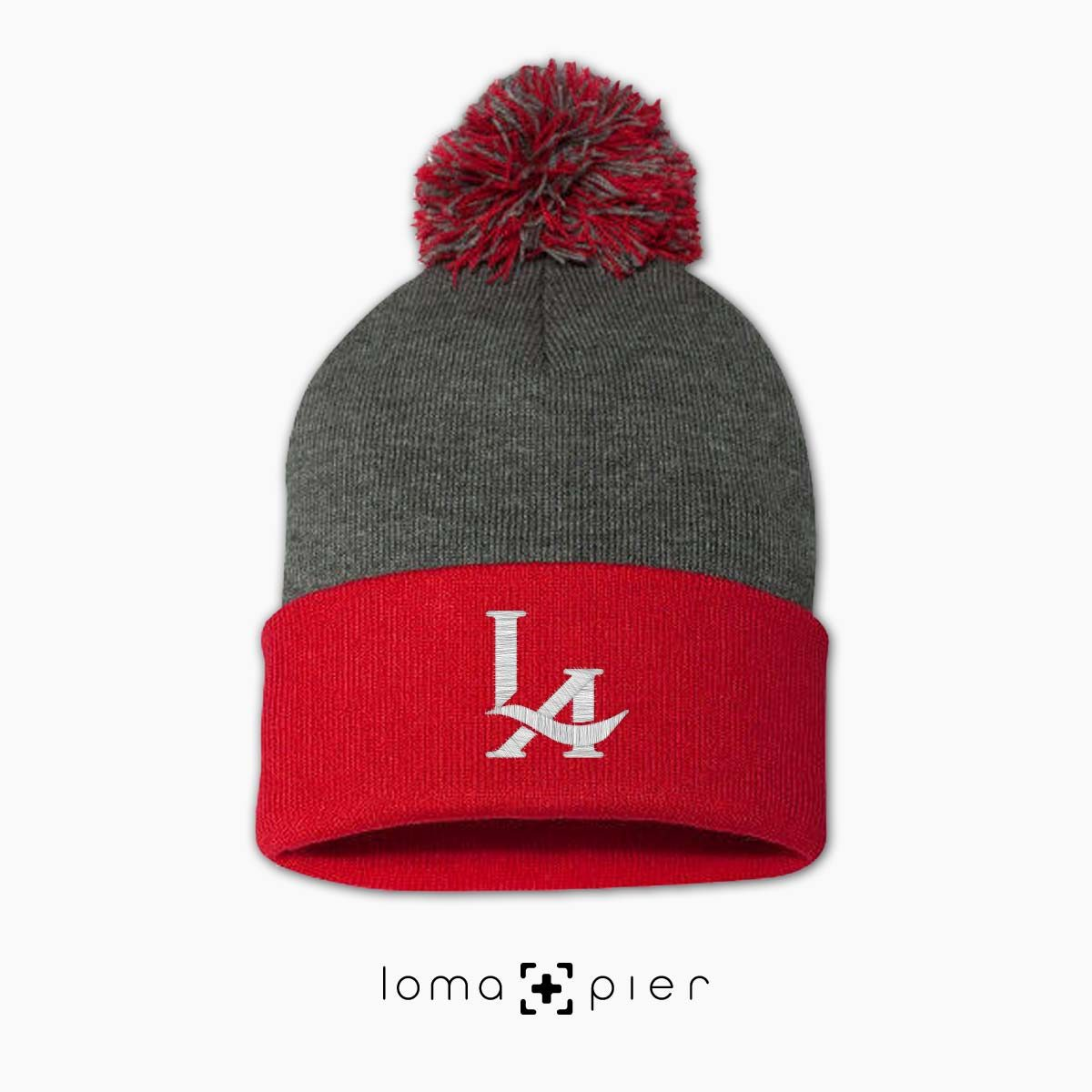 los angeles LA LOGO icon embroidered on a grey red pom pom beanie by loma+pier hat store