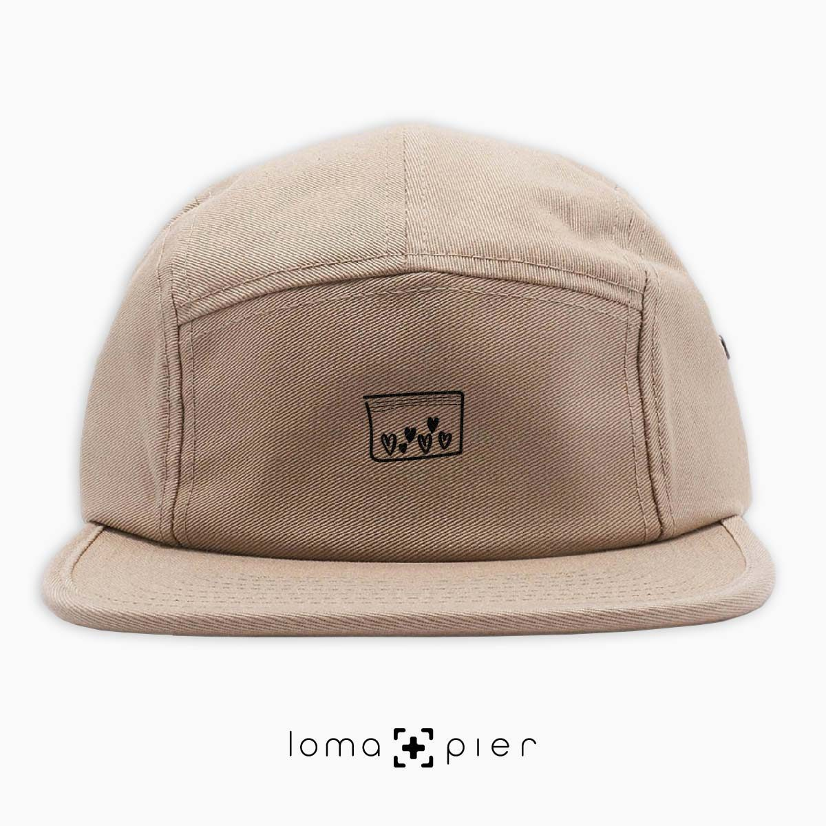 LOVE DRUG icon embroidered on a khaki cotton 5-panel hat with black thread by loma+pier hat store