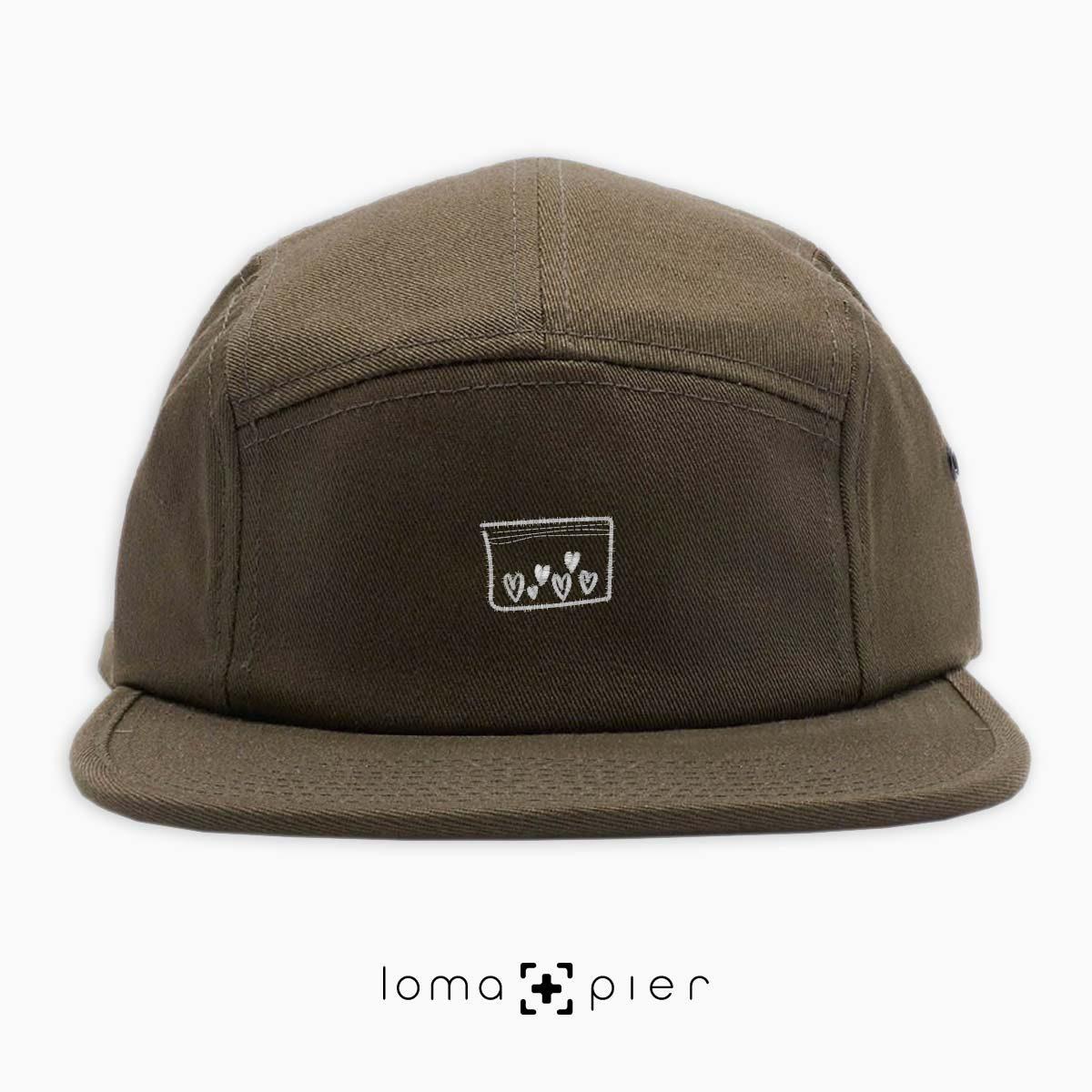 LOVE DRUG icon embroidered on an olive green cotton 5-panel hat with white thread by loma+pier hat store