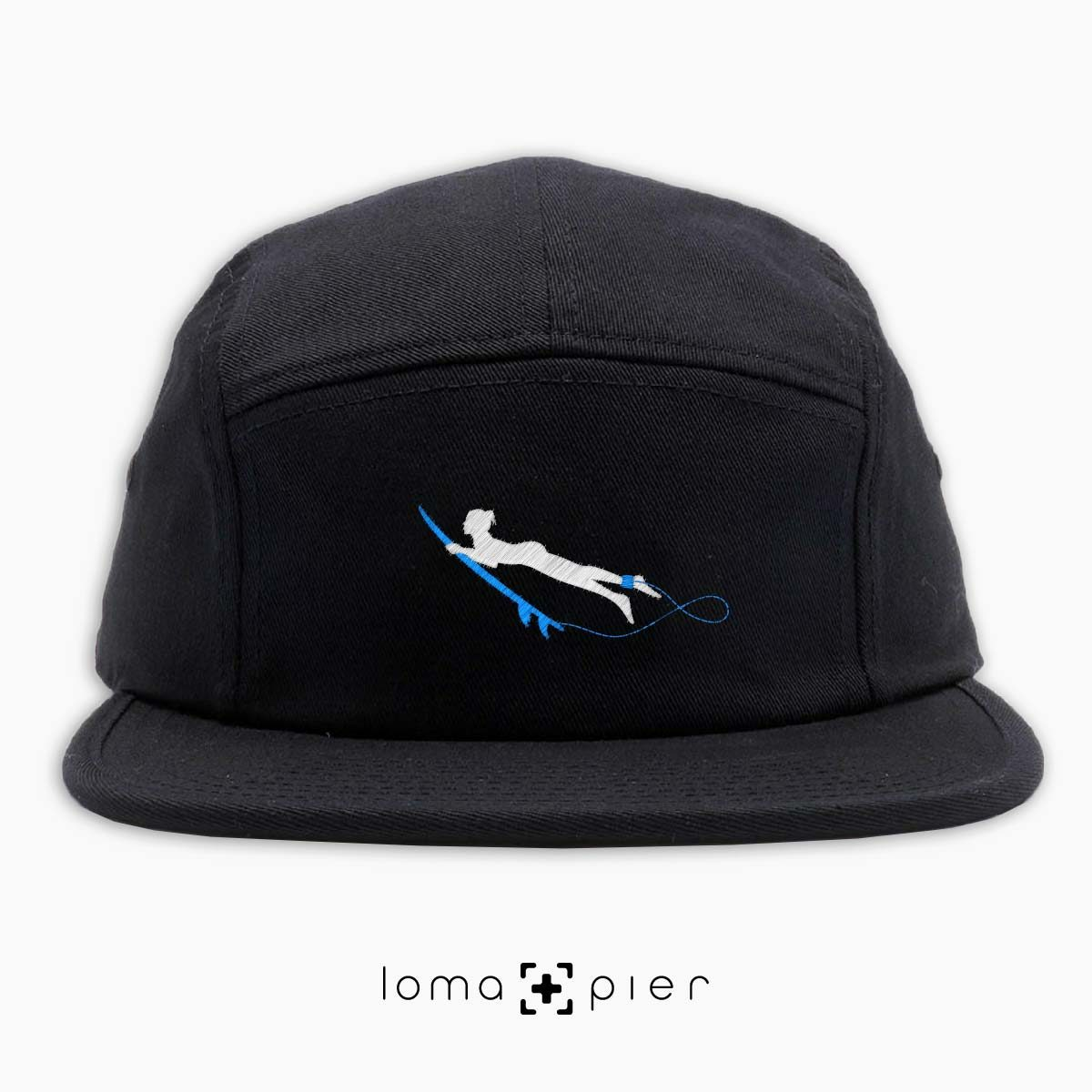 DUCK NAKED surfer icon embroidered on a black cotton 5-panel hat by loma+pier hat store