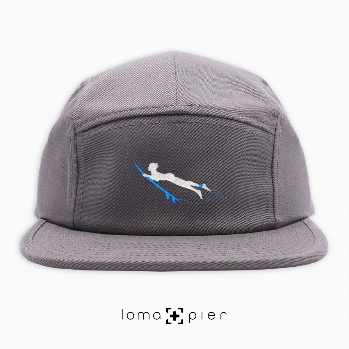 DUCK NAKED surfer icon embroidered on a grey cotton 5-panel hat by loma+pier hat store