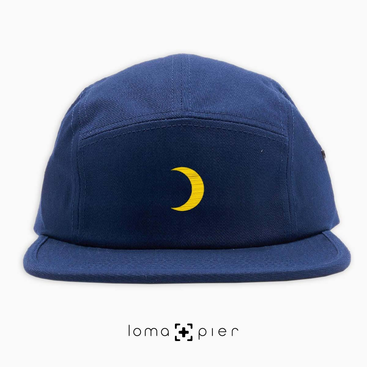 MOON icon embroidered on a navy blue cotton 5-panel hat by loma+pier hat store