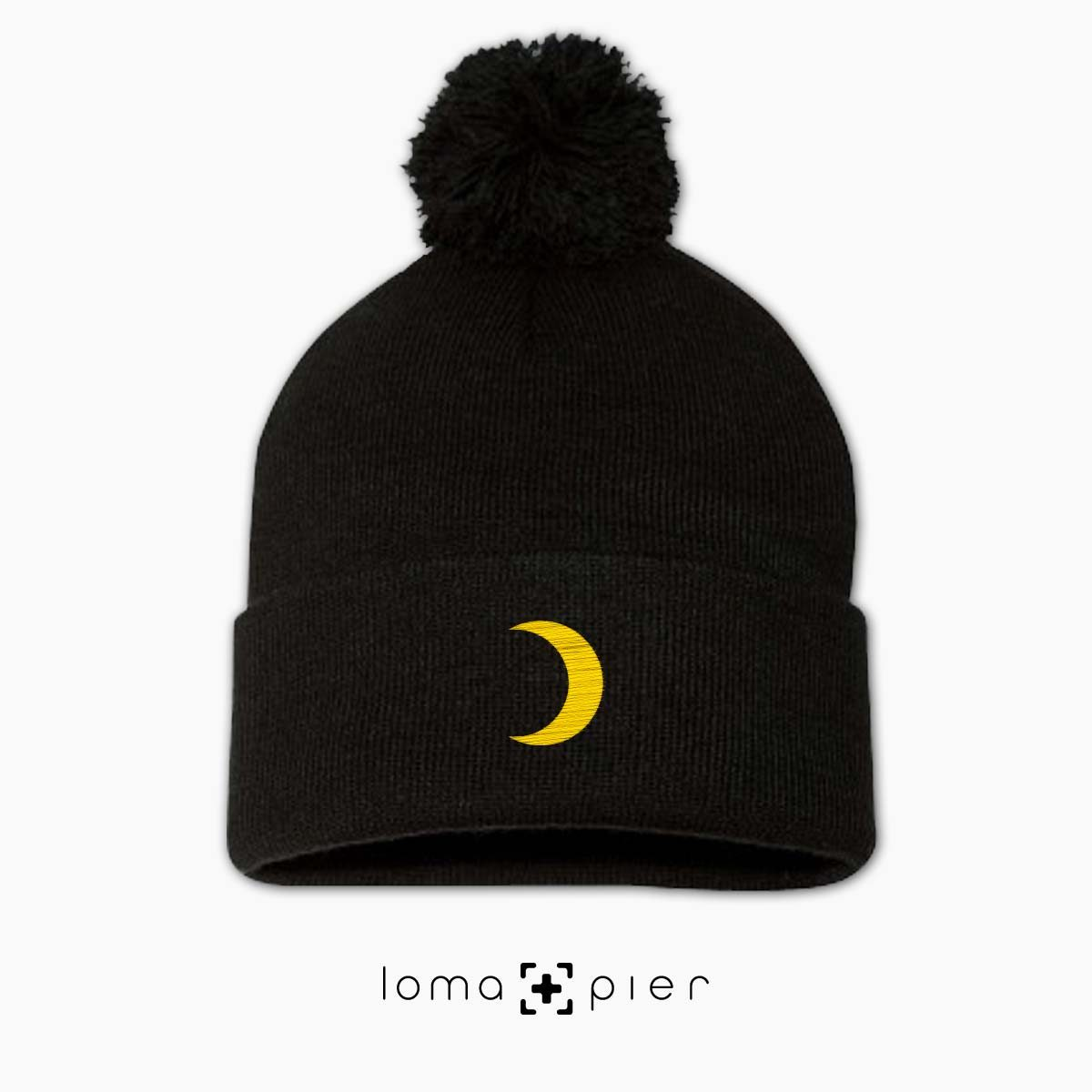 MOON icon embroidered on a black pom pom beanie by loma+pier beanie store