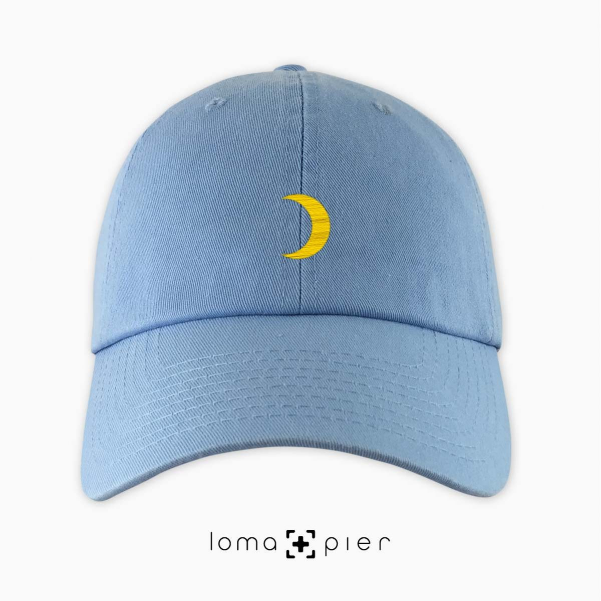 MOON icon embroidered on a light blue dad hat by loma+pier hat store made in the USA