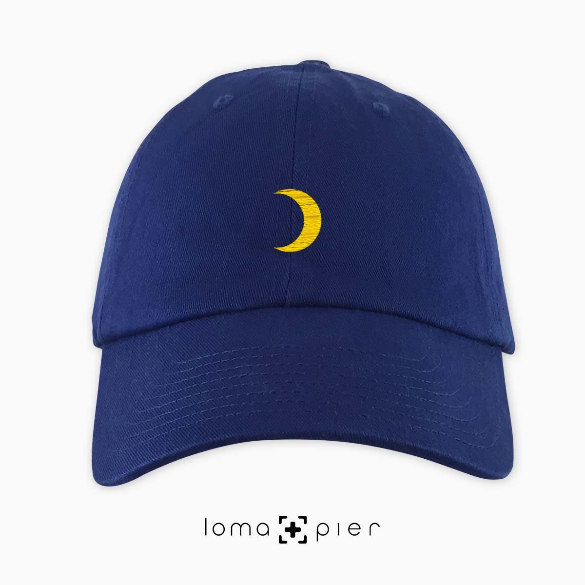 MOON icon embroidered on a royal blue dad hat by loma+pier hat store made in the USA