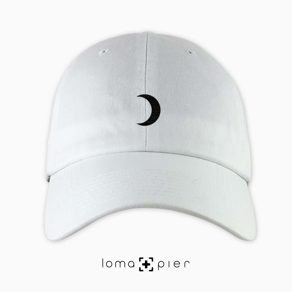 MOON icon embroidered on a white dad hat by loma+pier hat store made in the USA