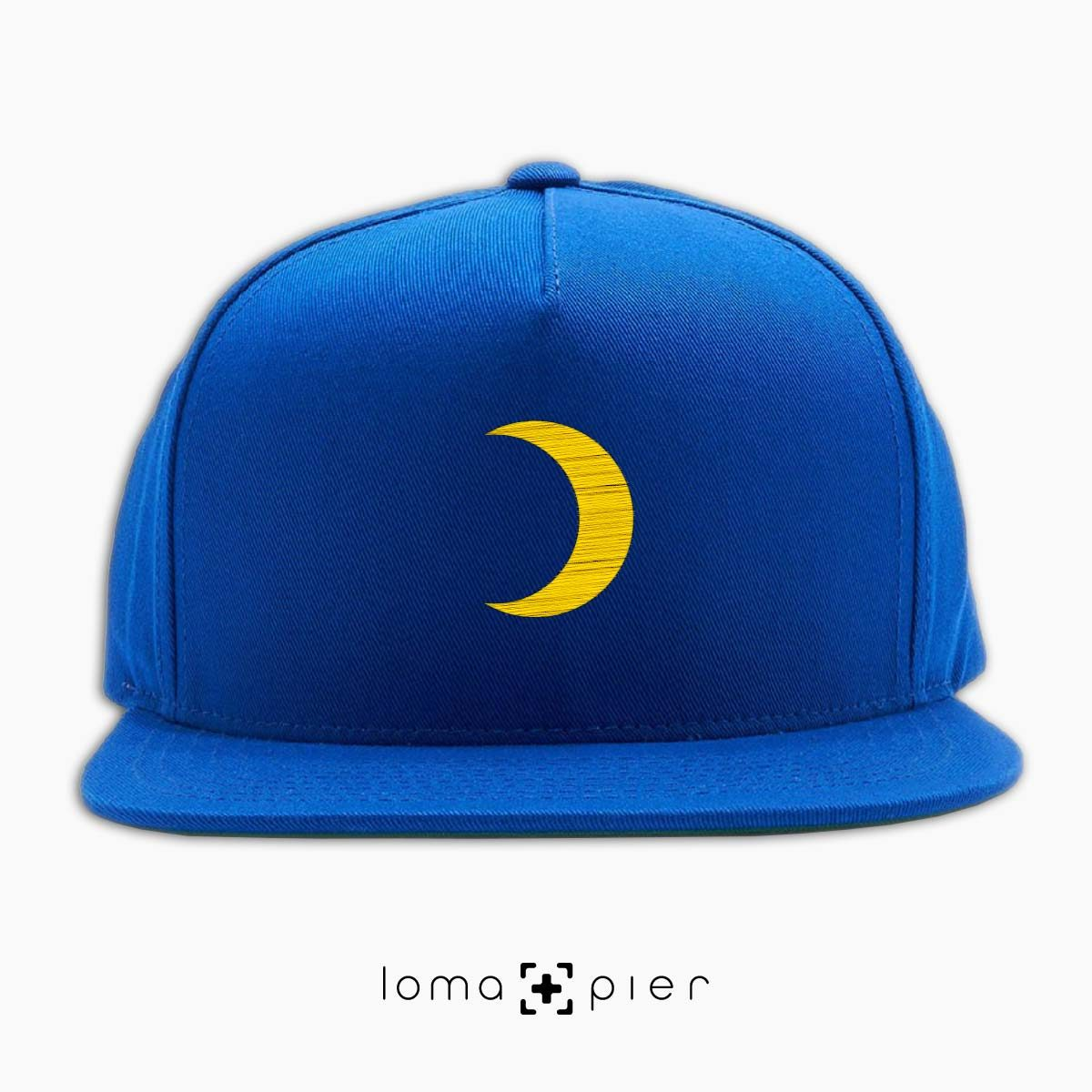 MOON icon embroidered on a blue classic snapback hat by loma+pier hat store