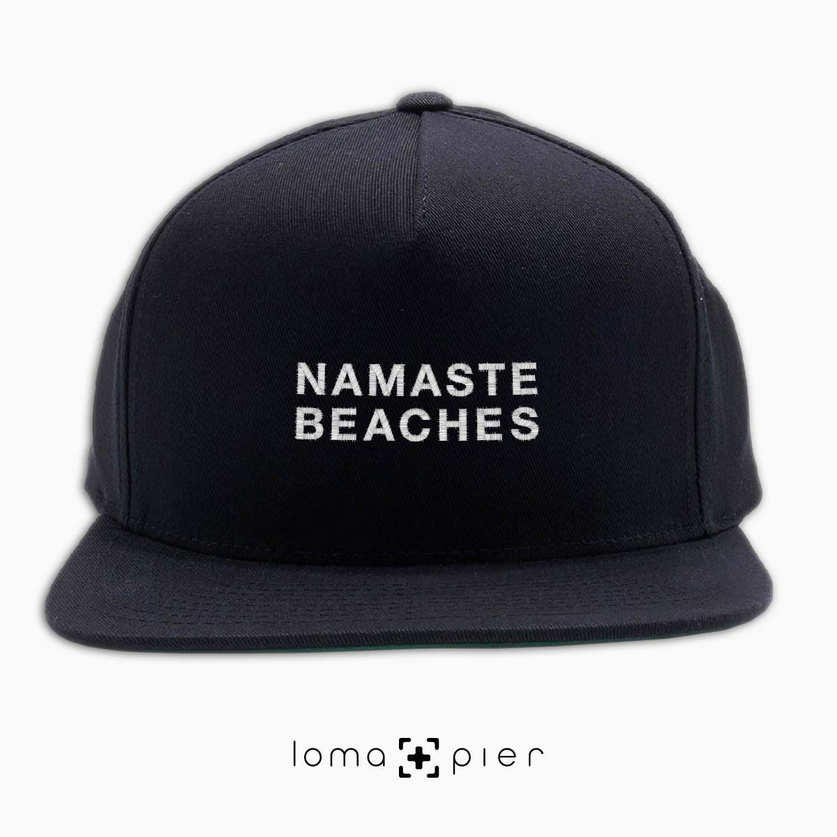 NAMASTE BEACHES hermosa beach yoga embroidered on a black classic snapback hat with white thread by loma+pier hat store
