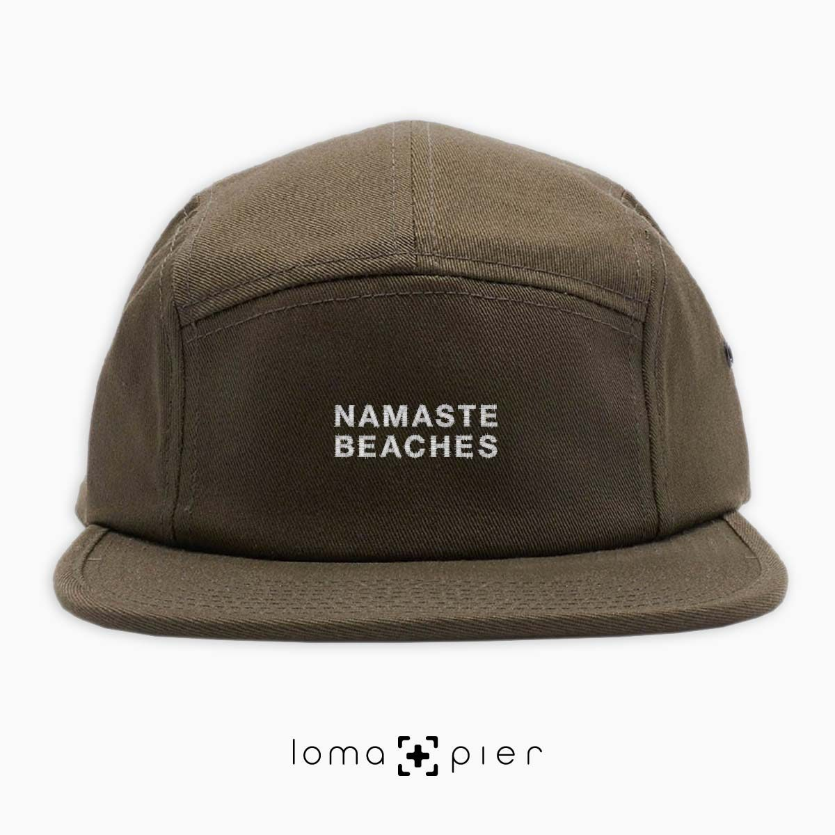 NAMASTE BEACHES hermosa beach yoga embroidered on an olive green cotton 5-panel hat by loma+pier hat store