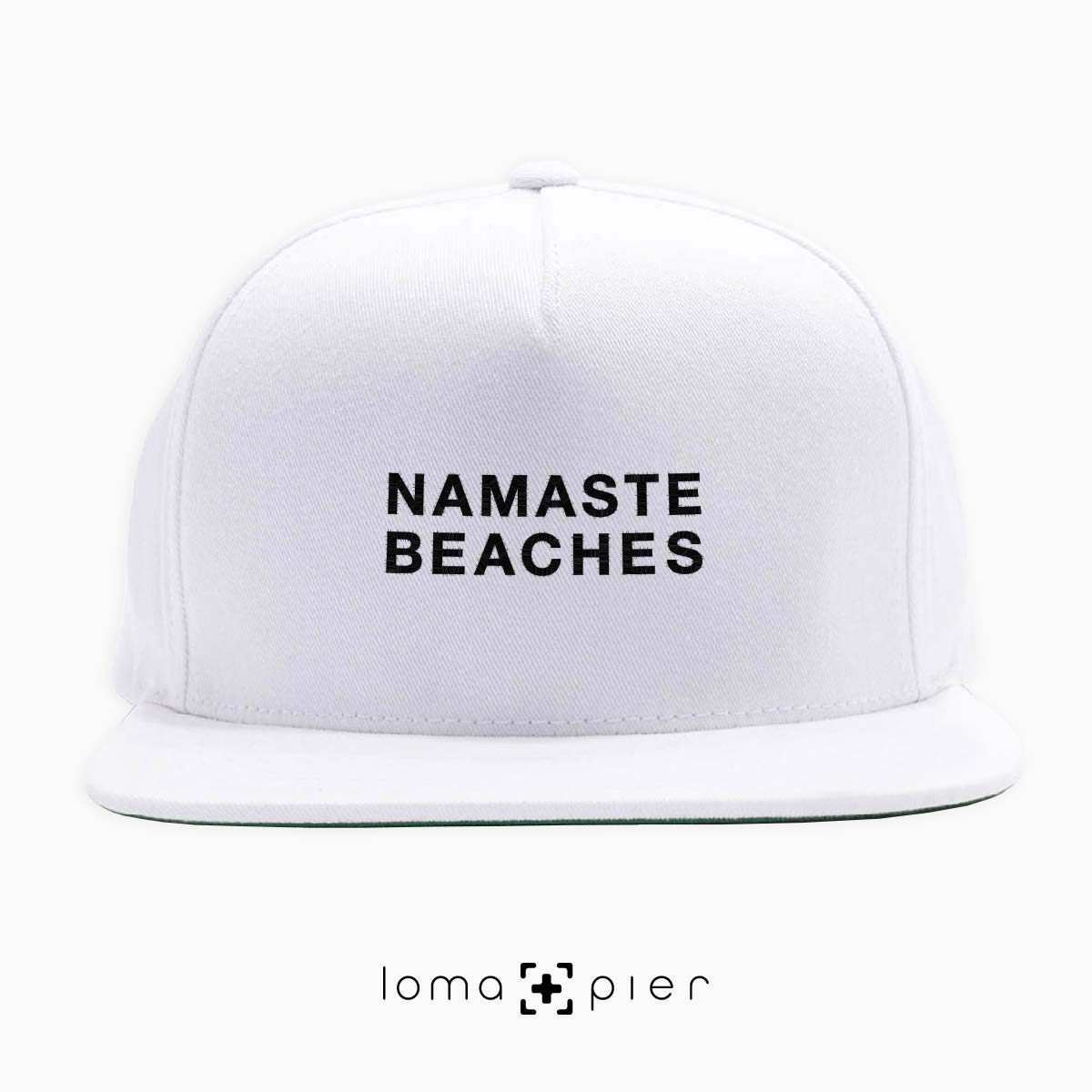NAMASTE BEACHES hermosa beach yoga embroidered on a white classic snapback hat with black thread by loma+pier hat store
