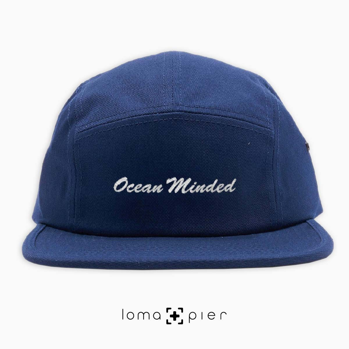 OCEAN MINDED embroidered on a navy blue cotton 5-panel hat by loma+pier hat store