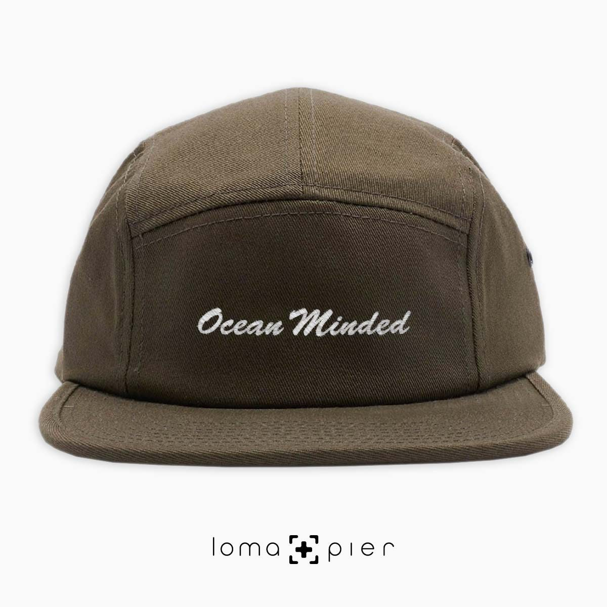 OCEAN MINDED embroidered on an olive green cotton 5-panel hat by loma+pier hat store