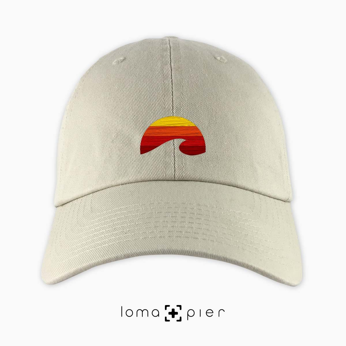 PACIFIC SUN icon embroidered on a khaki dad hat by loma+pier hat store made in the USA