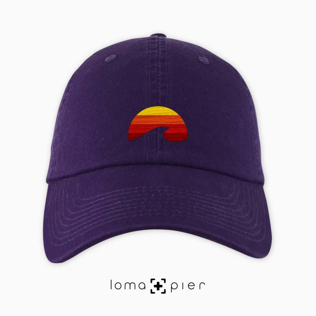 PACIFIC SUN icon embroidered on a purple dad hat by loma+pier hat store made in the USA