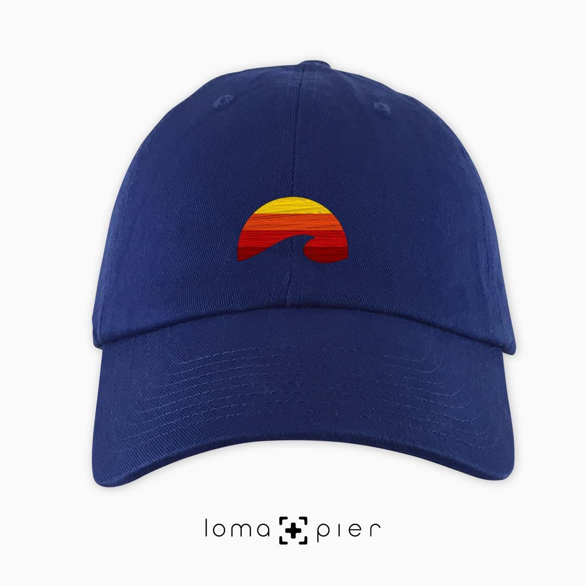 PACIFIC SUN icon embroidered on a royal blue dad hat by loma+pier hat store made in the USA