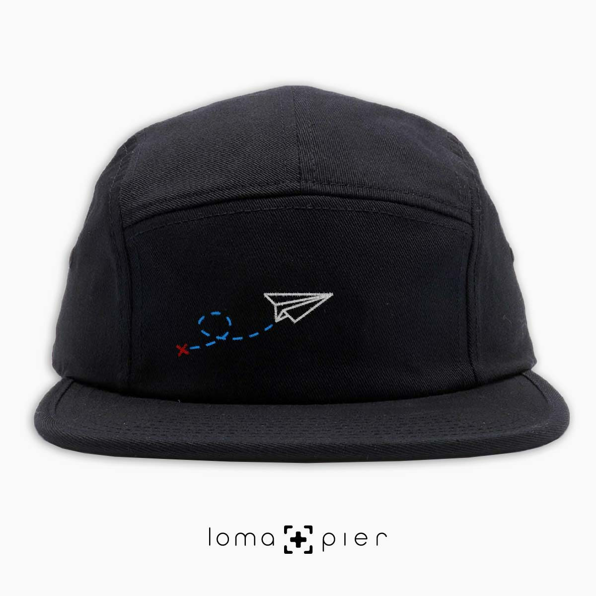 PAPER AIRPLANE icon embroidered on a black cotton 5-panel hat by loma+pier hat store